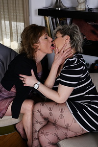 Two naughty housewives getting their lesbian groove on