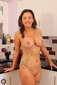 Hot British MILF playing with herself in the kitchen