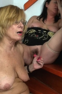 Lesbian matures alone at home getting naughty and using their sextoys to fuck each other