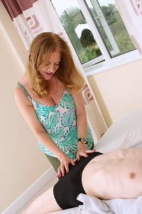 Big breasted British housewife having fun with her toy boy