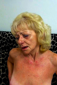 Desperate granny fucking her pussy with whatever she can find