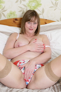 Horny British housewife playing in bed