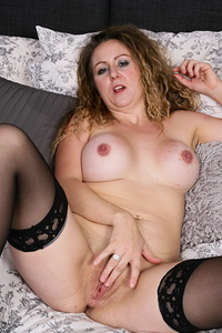 Naughty British housewife playing with her toys in bed
