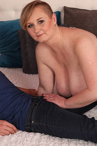 Big breasted mama fooling around with the guy next door