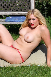 British housewife getting sun tanned in the garden
