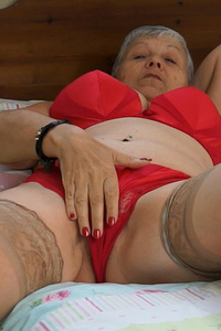 Hot granny exposing her red underweares before she masturbates herself