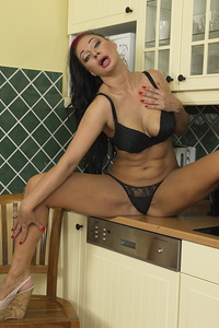 Naughty mom playing in her kitchen