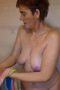 Grannny was caought while she was taking shower and now she poses to camera