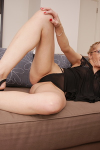 Naughty European housewife playing with herself on the couch