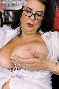 Mature lady is horny and alone in the office stripping down and playing